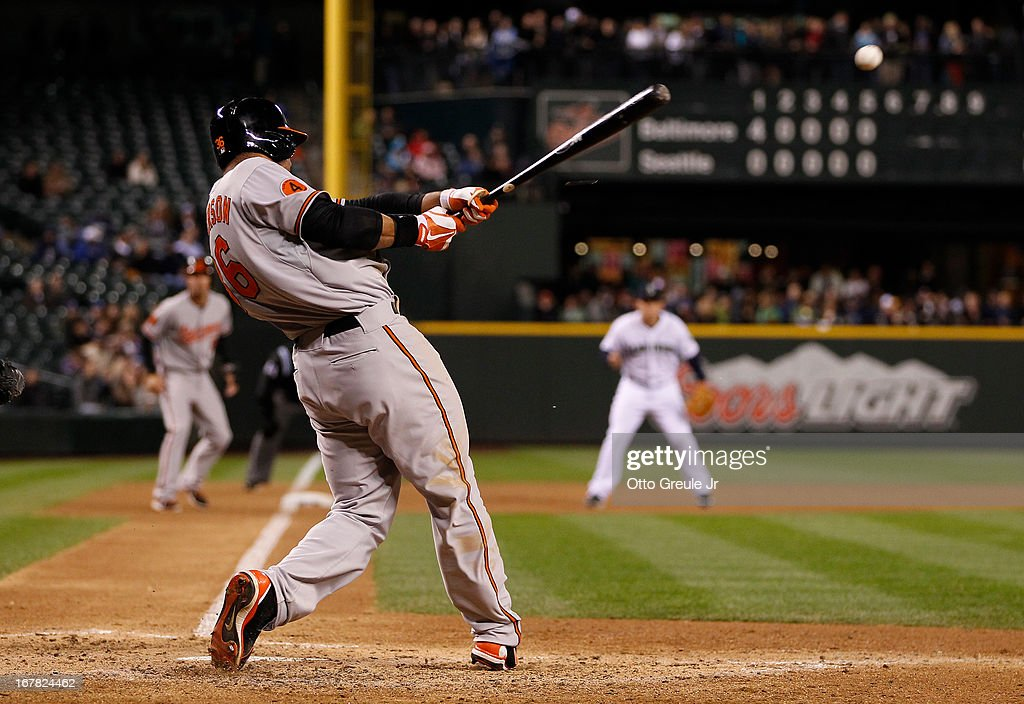 Chris Dickerson #36 of the Baltimore Orioles hits a two-RBI single in the sixth inning against the Seattle Mariners at Safeco Field on April 30, 2013 in Seattle, Washington.