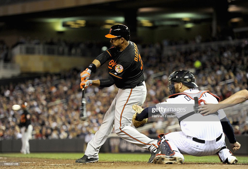 Chris Dickerson #36 of the Baltimore Orioles hits an RBI single as <a gi-track='captionPersonalityLinkClicked' href=/galleries/search?phrase=Ryan+Doumit&family=editorial&specificpeople=598785 ng-click='$event.stopPropagation()'>Ryan Doumit</a> #9 of the Minnesota Twins catches during the sixth inning of the game on May 10, 2013 at Target Field in Minneapolis, Minnesota.