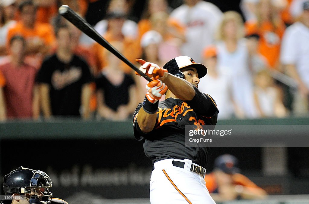 Chris Dickerson #36 of the Baltimore Orioles hits the game winning home run in the ninth inning against the Detroit Tigers at Oriole Park at Camden Yards on May 31, 2013 in Baltimore, Maryland. Baltimore won the game 7-5.