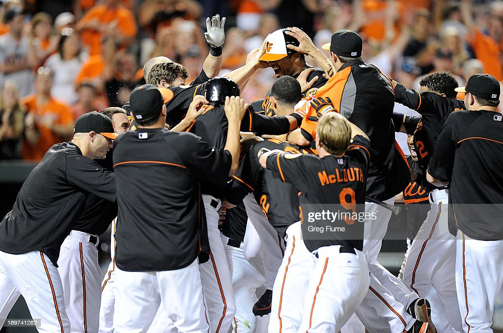 Chris Dickerson #36 of the Baltimore Orioles is mobbed by teammates after hitting the game winning home run in the ninth inning against the Detroit Tigers at Oriole Park at Camden Yards on May 31, 2013 in Baltimore, Maryland. Baltimore won the game 7-5.