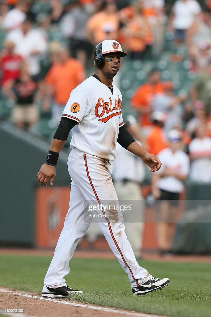 Chris Dickerson #36 of the Baltimore Orioles walks off the field after being forced out in a double play against the Chicago White Sox to end the game at Oriole Park at Camden Yards on September 8, 2013 in Baltimore, Maryland. The White Sox won 4-2.