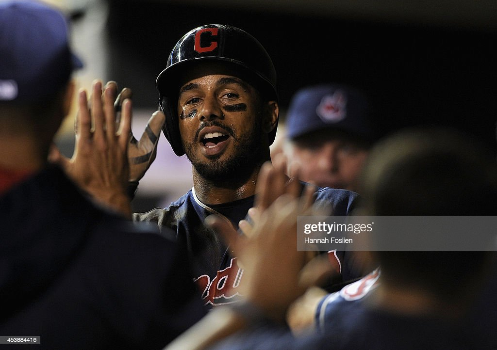 Chris Dickerson #38 of the Cleveland Indians celebrates scoring a run against the Minnesota Twins during the seventh inning of the game on August 20, 2014 at Target Field in Minneapolis, Minnesota. The Indians defeated the Twins 5-0.