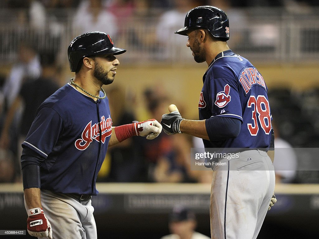 Chris Dickerson #38 of the Cleveland Indians congratulates teammate <a gi-track='captionPersonalityLinkClicked' href=/galleries/search?phrase=Mike+Aviles&family=editorial&specificpeople=4944765 ng-click='$event.stopPropagation()'>Mike Aviles</a> #4 on his solo home run against the Minnesota Twins during the ninth inning of the game on August 20, 2014 at Target Field in Minneapolis, Minnesota. The Indians defeated the Twins 5-0.