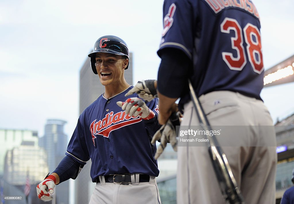 Chris Dickerson #38 of the Cleveland Indians congratulates teammate Zach Walters #6 on his solo home run against the Minnesota Twins during the second inning of the game on August 20, 2014 at Target Field in Minneapolis, Minnesota.