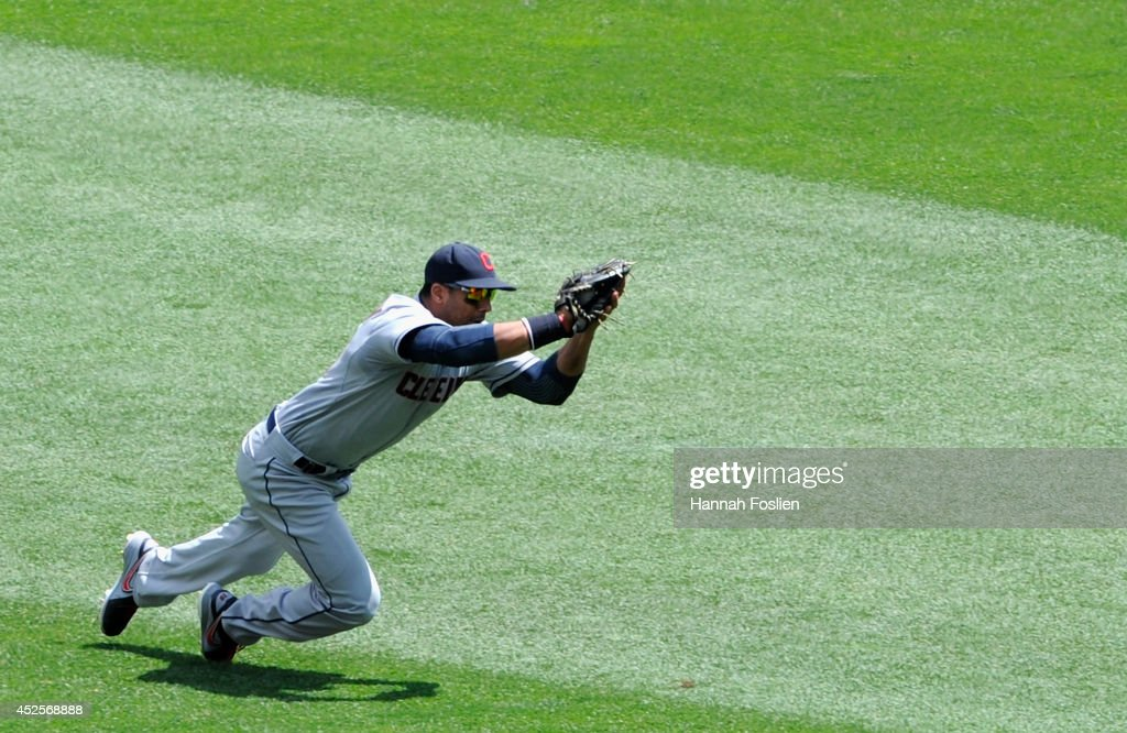Chris Dickerson #38 of the Cleveland Indians makes a catch of the ball hit by Eduardo Nunez #9 of the Minnesota Twins during the fourth inning of the game on July 23, 2014 at Target Field in Minneapolis, Minnesota. The Twins defeated the Indians 3-1.