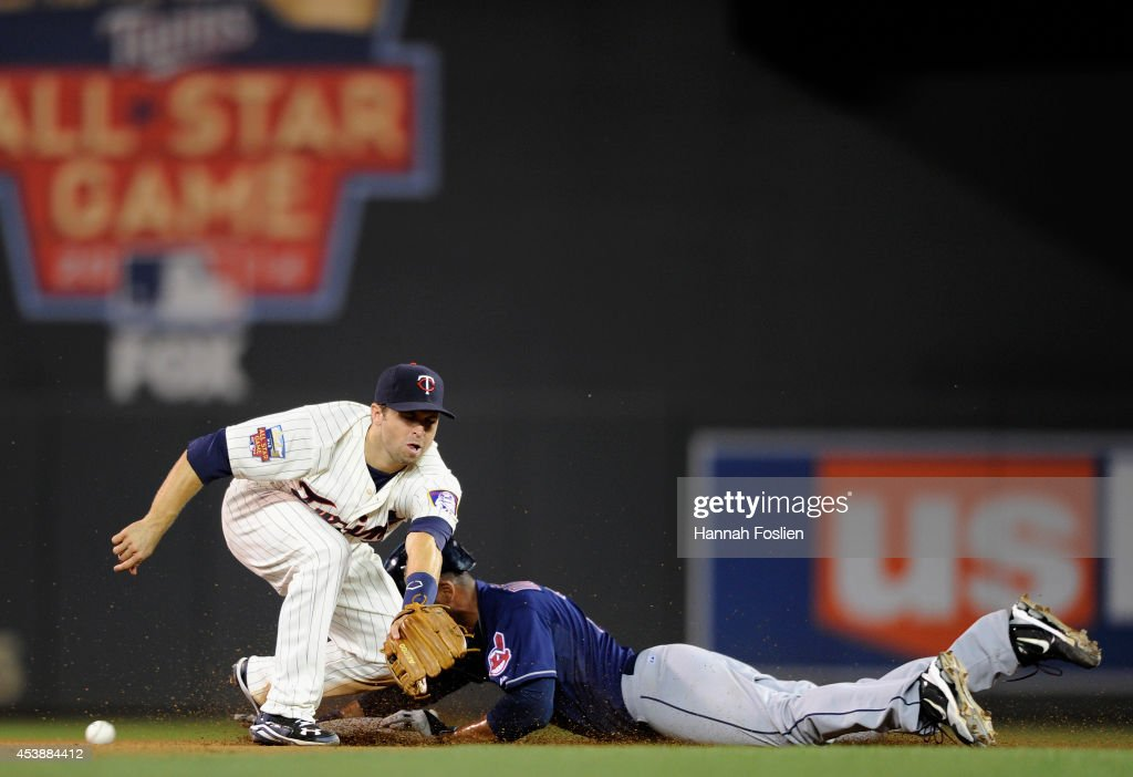 Chris Dickerson #38 of the Cleveland Indians steals second base as <a gi-track='captionPersonalityLinkClicked' href=/galleries/search?phrase=Brian+Dozier&family=editorial&specificpeople=7553002 ng-click='$event.stopPropagation()'>Brian Dozier</a> #2 of the Minnesota Twins is unable to field the throw during the seventh inning of the game on August 20, 2014 at Target Field in Minneapolis, Minnesota. The Indians defeated the Twins 5-0.