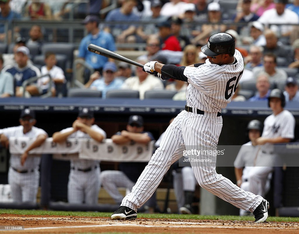 Chris Dickerson #60 of the New York Yankees hits a two-run home run against the Baltimore Orioles at Yankee Stadium on September 2, 2012 in the Bronx borough of New York City.