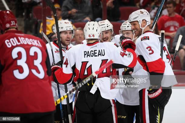 Chris DiDomenico JeanGabriel Pageau Erik Karlsson Clarke MacArthur and Marc Methot of the Ottawa Senators celebrate after Karlsson scored a third...