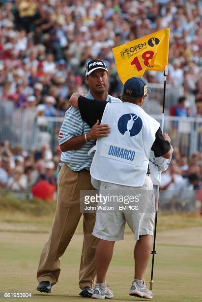 Chris DiMarco USA celebrates with his caddie on the 18th green