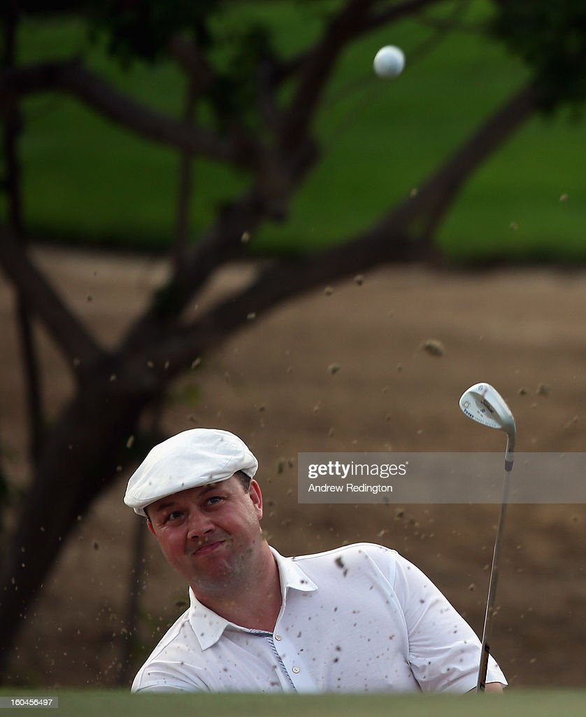 Chris Doak of Scotland plays a bunker shot on the 15th hole during the second round of the Omega Dubai Desert Classic at Emirates Golf Club on February 1, 2013 in Dubai, United Arab Emirates.