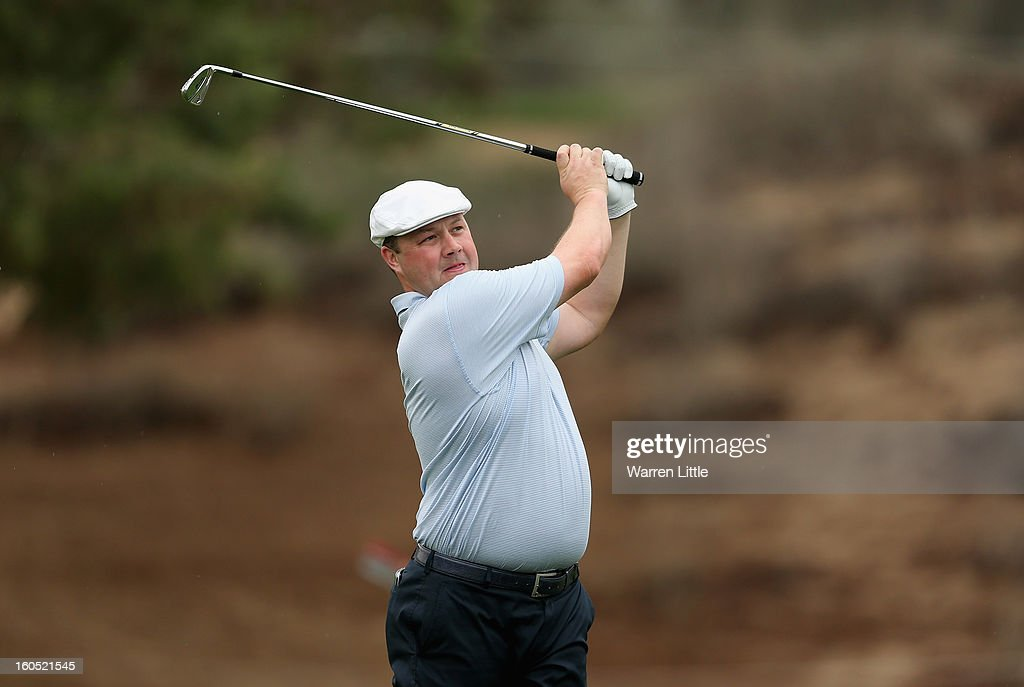 Chris Doak of Scotland plays his second shot on the eighth hole during the third round of the Omega Dubai Desert Classic at Emirates Golf Club on February 2, 2013 in Dubai, United Arab Emirates.