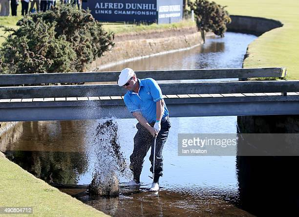 Chris Doak of Scotland plays his second shot out from the burn on the first hole during the first round of the 2015 Alfred Dunhill Links Championship...