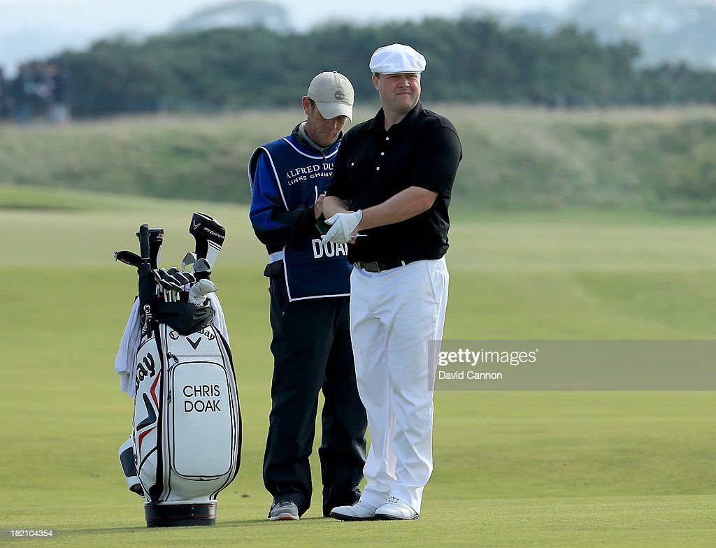 Chris Doak of Scotland with his caddie on the sixth hole during the third round of the Alfred Dunhill Links Championship on The Old Course, at St Andrews on September 28, 2013 in St Andrews, Scotland.