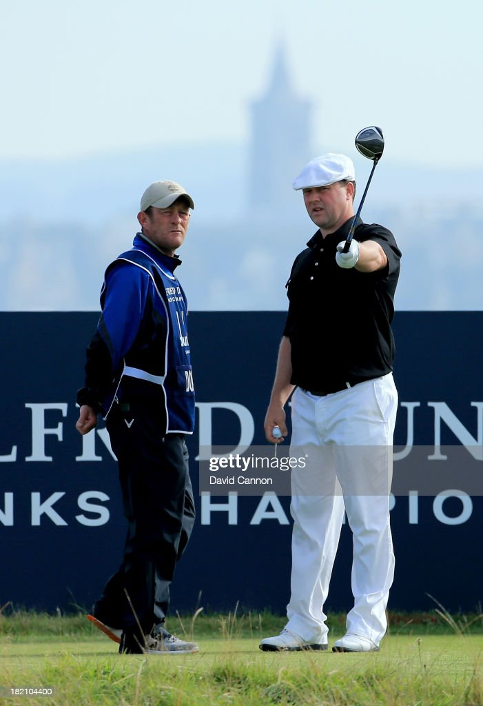 Chris Doak of Scotland with his caddy on the sxth tee during the third round of the Alfred Dunhill Links Championship on The Old Course, at St Andrews on September 28, 2013 in St Andrews, Scotland.