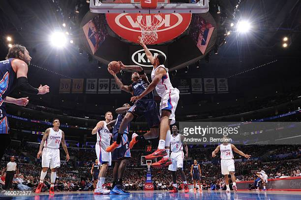 Chris DouglasRoberts of the Charlotte Bobcats attempts a shot against Ryan Hollins of the Los Angeles Clippers at STAPLES Center on January 1 2013 in...