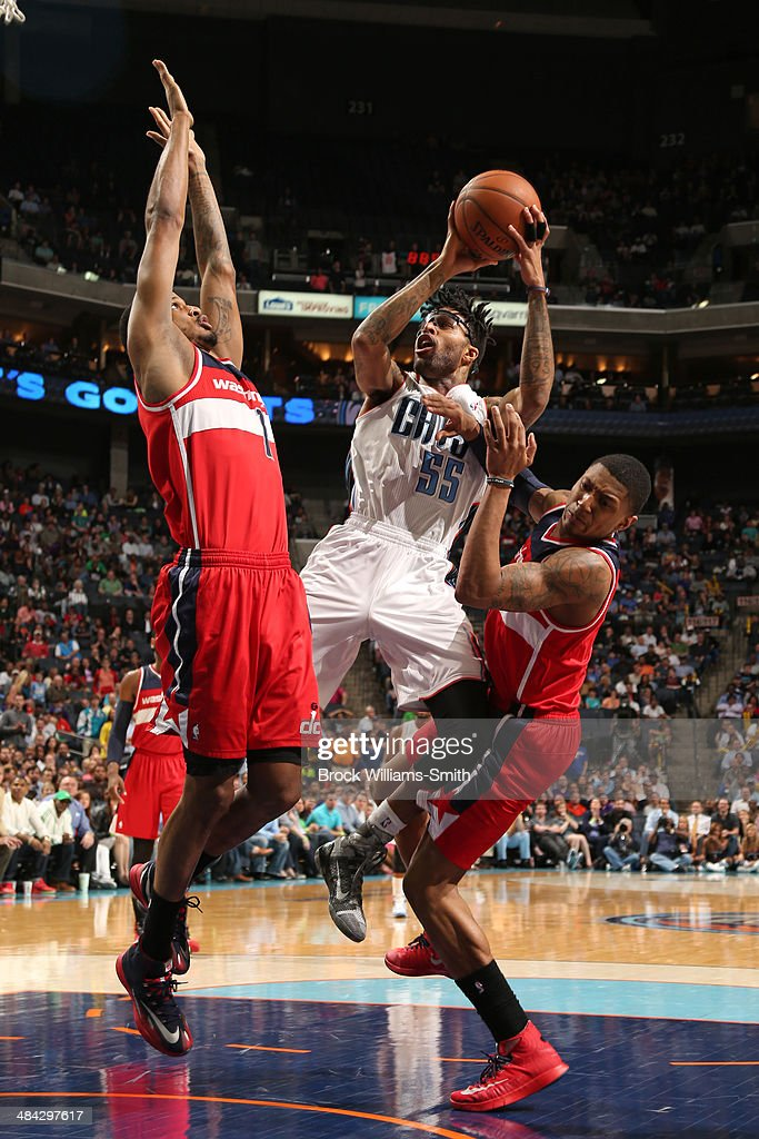 <a gi-track='captionPersonalityLinkClicked' href=/galleries/search?phrase=Chris+Douglas-Roberts&family=editorial&specificpeople=728571 ng-click='$event.stopPropagation()'>Chris Douglas-Roberts</a> #55 of the Charlotte Bobcats goes up for a shot against the Washington Wizards at the Time Warner Cable Arena on March 31, 2014 in Charlotte, North Carolina.