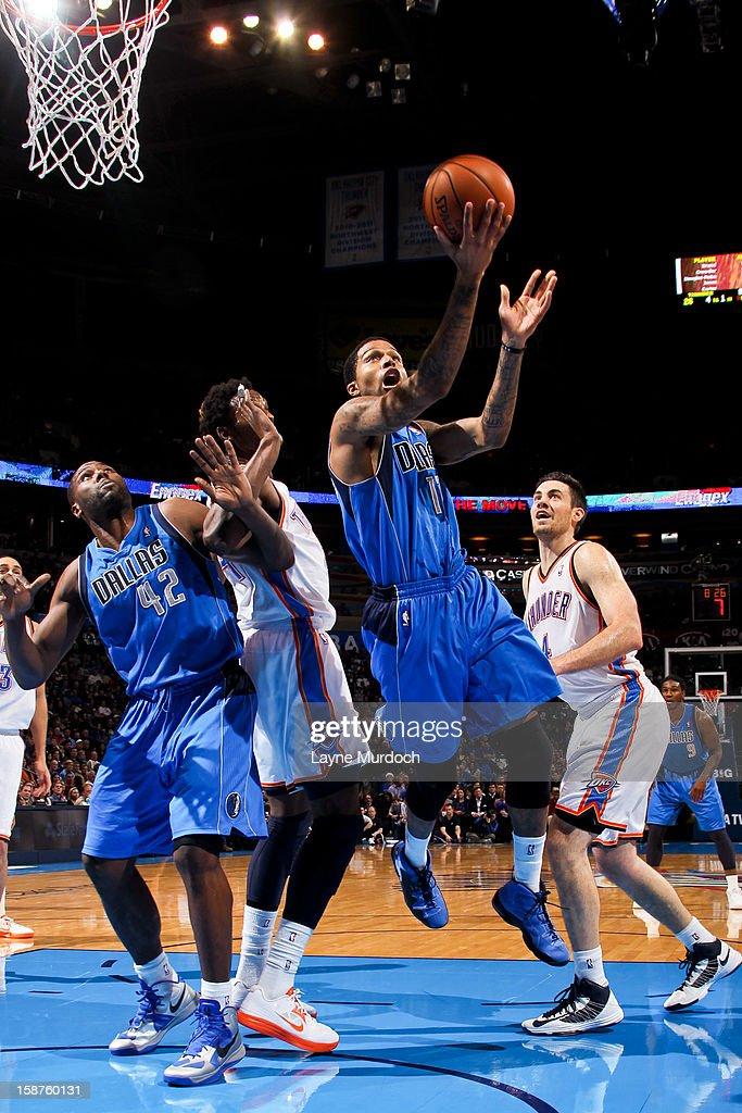 Chris Douglas-Roberts #17 of the Dallas Mavericks drives to the basket against the Oklahoma City Thunder on December 27, 2012 at the Chesapeake Energy Arena in Oklahoma City, Oklahoma.