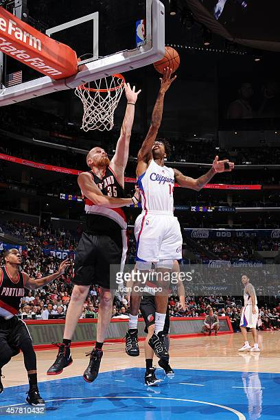 Chris DouglasRoberts of the Los Angeles Clippers shoots against Chris Kaman of the Portland Trail Blazers during the game on October 24 2014 at the...