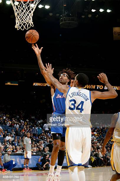 Chris DouglasRoberts of the Los Angeles Clippers shoots against the Golden State Warriors on November 5 2014 at Oracle Arena in Oakland California...
