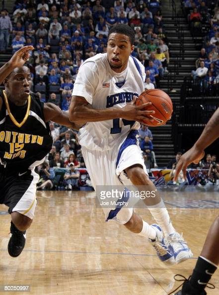 Chris DouglasRoberts of the Memphis Tigers drives past RL Horton of the Southern Miss Golden Eagles during the semifinals of the Conference USA...