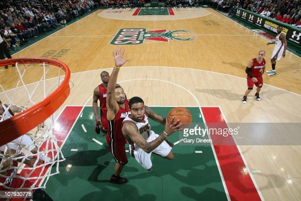 Chris DouglasRoberts of the Milwaukee Bucks shoots a layup against Juwan Howard of the Miami Heat during the NBA game on January 7 2011 at the...