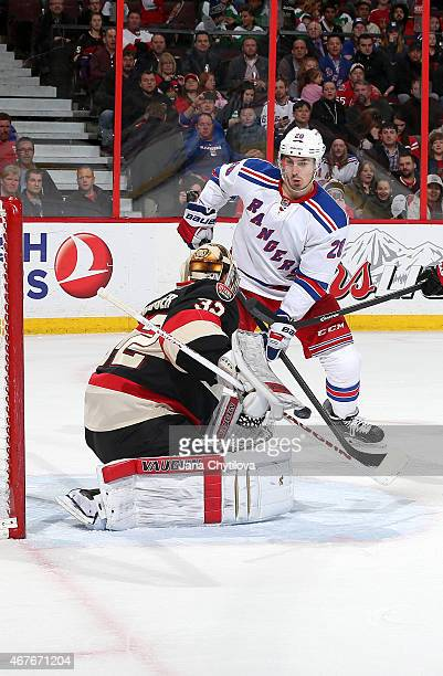 Chris Driedger of the Ottawa Senators makes a save against Chris Kreider of the New York Rangers in the second period at Canadian Tire Centre on...