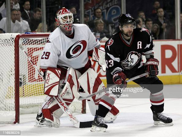 Chris Drury of the Buffalo Sabres tries to distract Hurricanes goalie Martin Gerber during game 3 of the Eastern Conference Finals versus at the HSBC...
