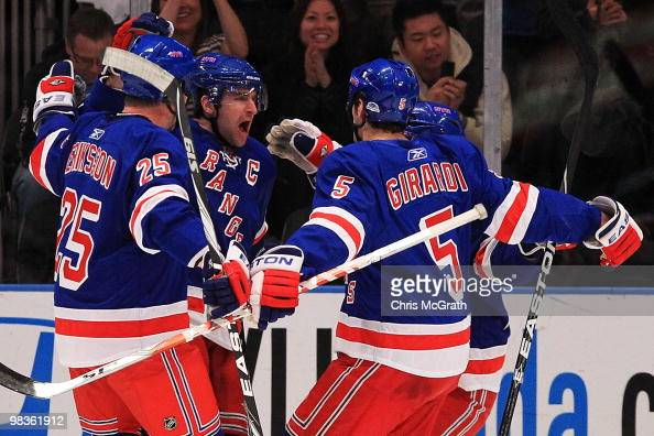Chris Drury of the New York Rangers celebrates scoring a goal with team mates Anders Eriksson and Dan Girardi of the New York Rangers against the...