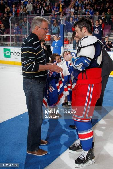 Chris Drury of the New York Rangers gives a lucky fan his gameused jersey after the game against the New Jersey Devils on April 9 2011 at Madison...