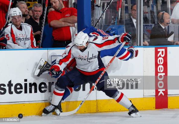 Chris Drury of the New York Rangers is checked along the boards by Boyd Gordon of the Washington Capitals in Game Four of the Eastern Conference...