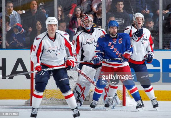 Chris Drury of the New York Rangers positions himself in front of the net against Michal Neuvirth of the Washington Capitals in Game Four of the...