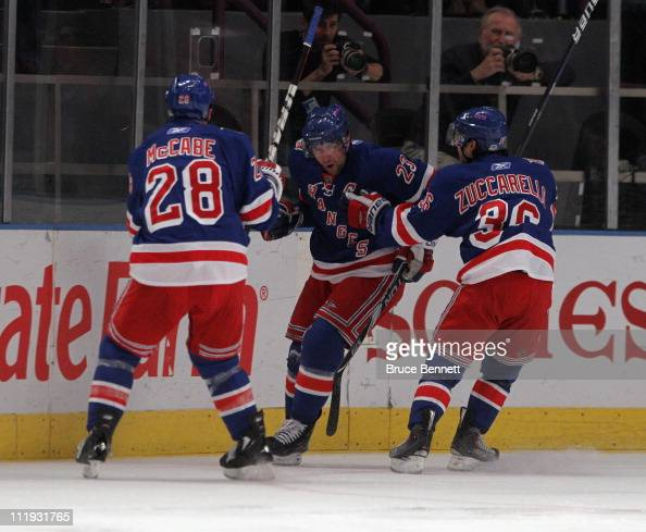 Chris Drury of the New York Rangers scores a first period goal and is joined by Bryan McCabe and Mats Zuccarello in their game against the New Jersey...