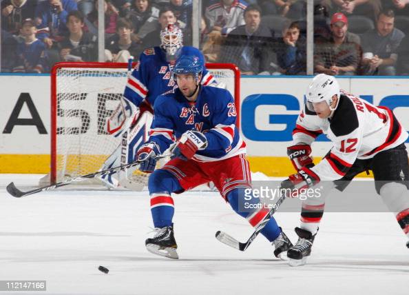 Chris Drury of the New York Rangers skates against Brian Rolston of the New Jersey Devils on April 9 2011 at Madison Square Garden in New York City