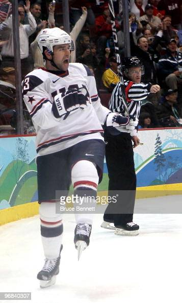 Chris Drury of The United States celebrates after scoring his team's second goal during the ice hockey men's preliminary game between USA and Norway...