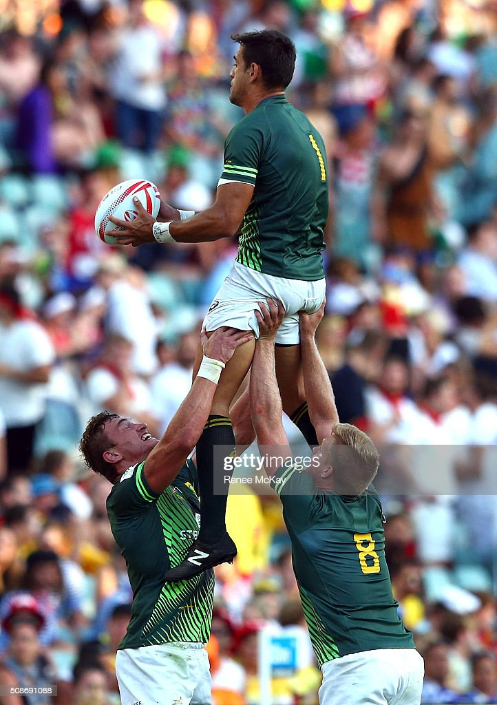 Chris Dry of South Africa is lifted in the line out by team mates Carel du Preez and Dylan Sage during the day 1 match between South Africa and Kenya at the HSBC Sydney Sevens at Allianz Stadium on February 06, 2016 in Sydney, Australia.