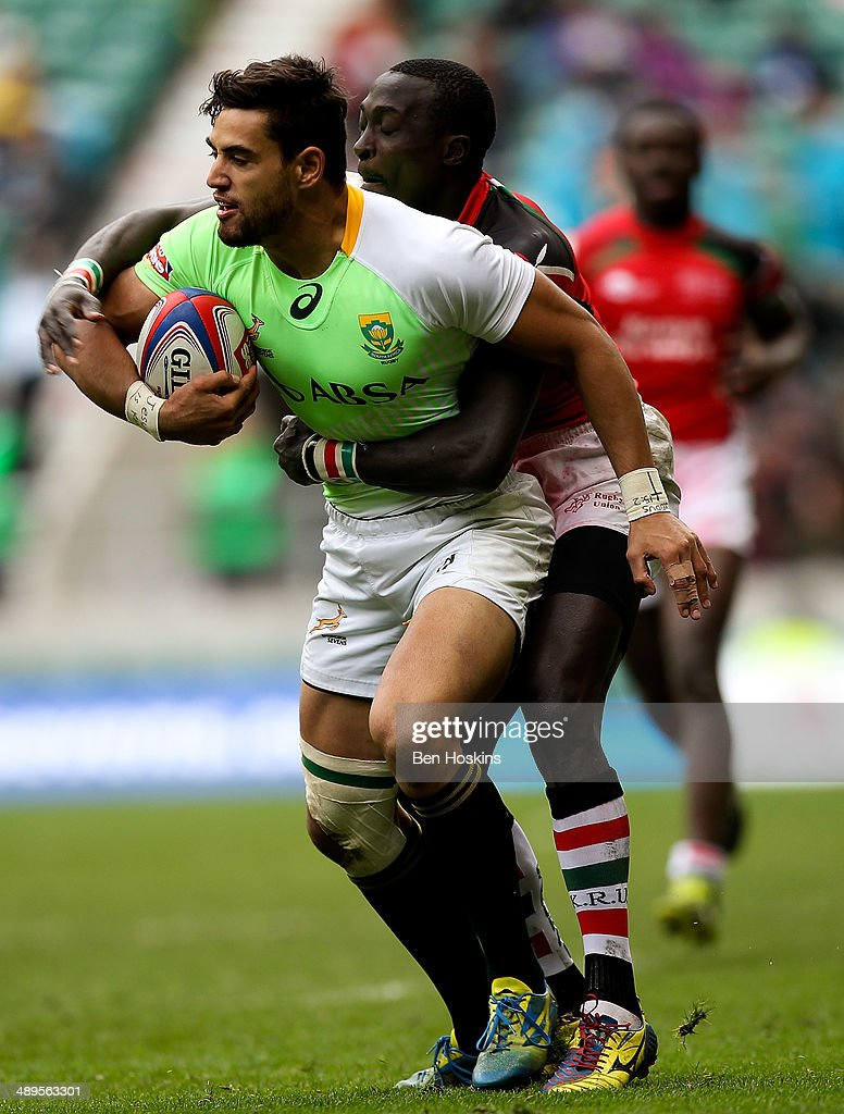 <a gi-track='captionPersonalityLinkClicked' href=/galleries/search?phrase=Chris+Dry&family=editorial&specificpeople=6474921 ng-click='$event.stopPropagation()'>Chris Dry</a> of South Africa is tackled by Biko Adema of Kenya during the Marriot London Sevens match between South Africa and Kenya at The Marriott London Sevens - Day 2 at Twickenham Stadium on May 11, 2014 in London, England.