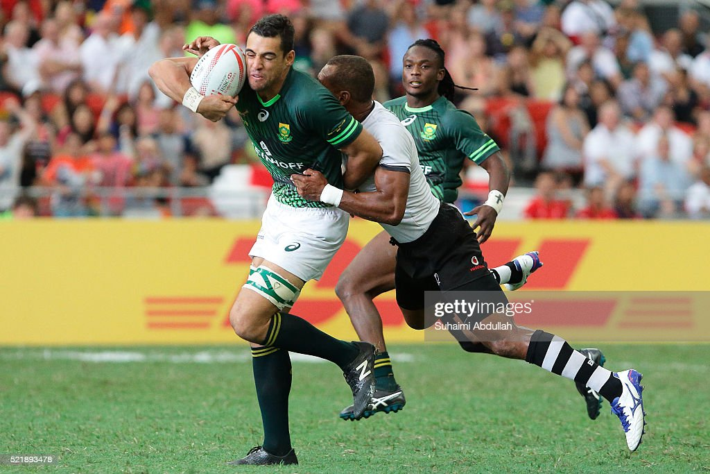 <a gi-track='captionPersonalityLinkClicked' href=/galleries/search?phrase=Chris+Dry&family=editorial&specificpeople=6474921 ng-click='$event.stopPropagation()'>Chris Dry</a> (L) of South Africa is tackled by <a gi-track='captionPersonalityLinkClicked' href=/galleries/search?phrase=Osea+Kolinisau&family=editorial&specificpeople=5709813 ng-click='$event.stopPropagation()'>Osea Kolinisau</a> of Fiji during the 2016 Singapore Sevens Cup Semi Final between Fiji and South Africa at National Stadium on April 17, 2016 in Singapore.