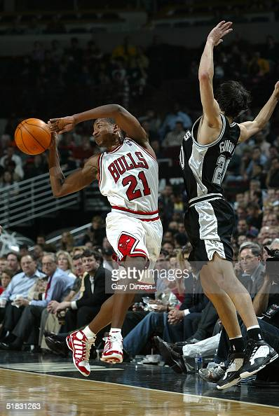 Chris Duhon of the Chicago Bulls passes the ball against Emanuel Ginobili of the San Antonio Spurs on December 6 2004 at the United Center in Chicago...