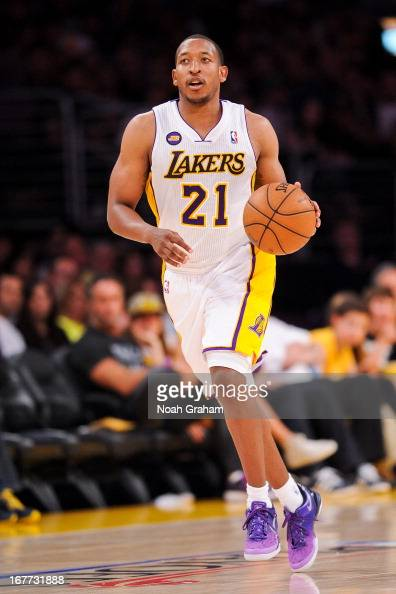 Chris Duhon of the Los Angeles Lakers advances the ball against the San Antonio Spurs in Game Four of the Western Conference Quarterfinals during the...