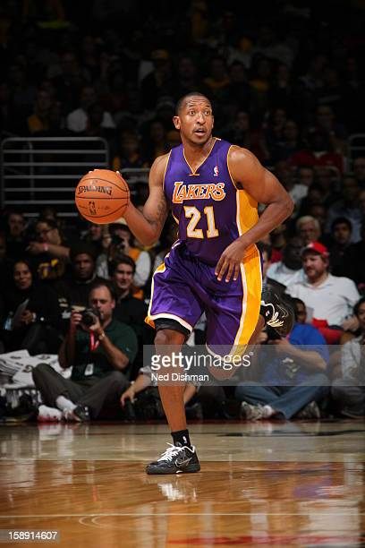 Chris Duhon of the Los Angeles Lakers brings the ball up court against the Washington Wizards at the Verizon Center on December 14 2012 in Washington...