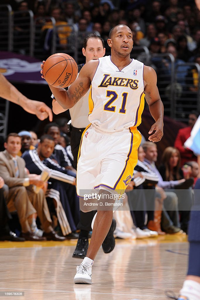 <a gi-track='captionPersonalityLinkClicked' href=/galleries/search?phrase=Chris+Duhon&family=editorial&specificpeople=202879 ng-click='$event.stopPropagation()'>Chris Duhon</a> #21 of the Los Angeles Lakers brings the ball up court against the Denver Nuggets at Staples Center on January 6, 2013 in Los Angeles, California.