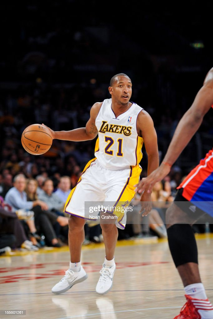 <a gi-track='captionPersonalityLinkClicked' href=/galleries/search?phrase=Chris+Duhon&family=editorial&specificpeople=202879 ng-click='$event.stopPropagation()'>Chris Duhon</a> #21 of the Los Angeles Lakers controls the ball against the Detroit Pistons at Staples Center on November 4, 2012 in Los Angeles, California.