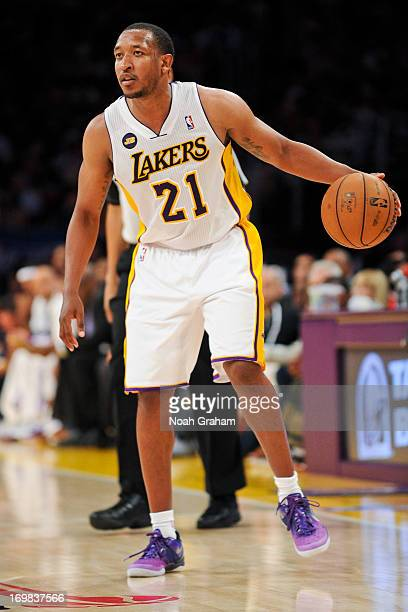 Chris Duhon of the Los Angeles Lakers controls the ball against the San Antonio Spurs in Game Four of the Western Conference Quarterfinals during the...