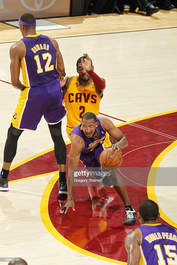 <a gi-track='captionPersonalityLinkClicked' href=/galleries/search?phrase=Chris+Duhon&family=editorial&specificpeople=202879 ng-click='$event.stopPropagation()'>Chris Duhon</a> #21 of the Los Angeles Lakers dribbles the ball up court against the Cleveland Cavaliers at The Quicken Loans Arena on December 11, 2012 in Cleveland, Ohio.