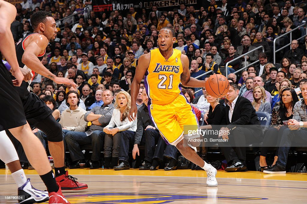 Chris Duhon #21 of the Los Angeles Lakers drives against Jared Jeffries #1 of the Portland Trail Blazers at Staples Center on December 28, 2012 in Los Angeles, California.