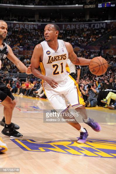 Chris Duhon of the Los Angeles Lakers drives against Tony Parker of the San Antonio Spurs in Game Four of the Western Conference Quarterfinals during...