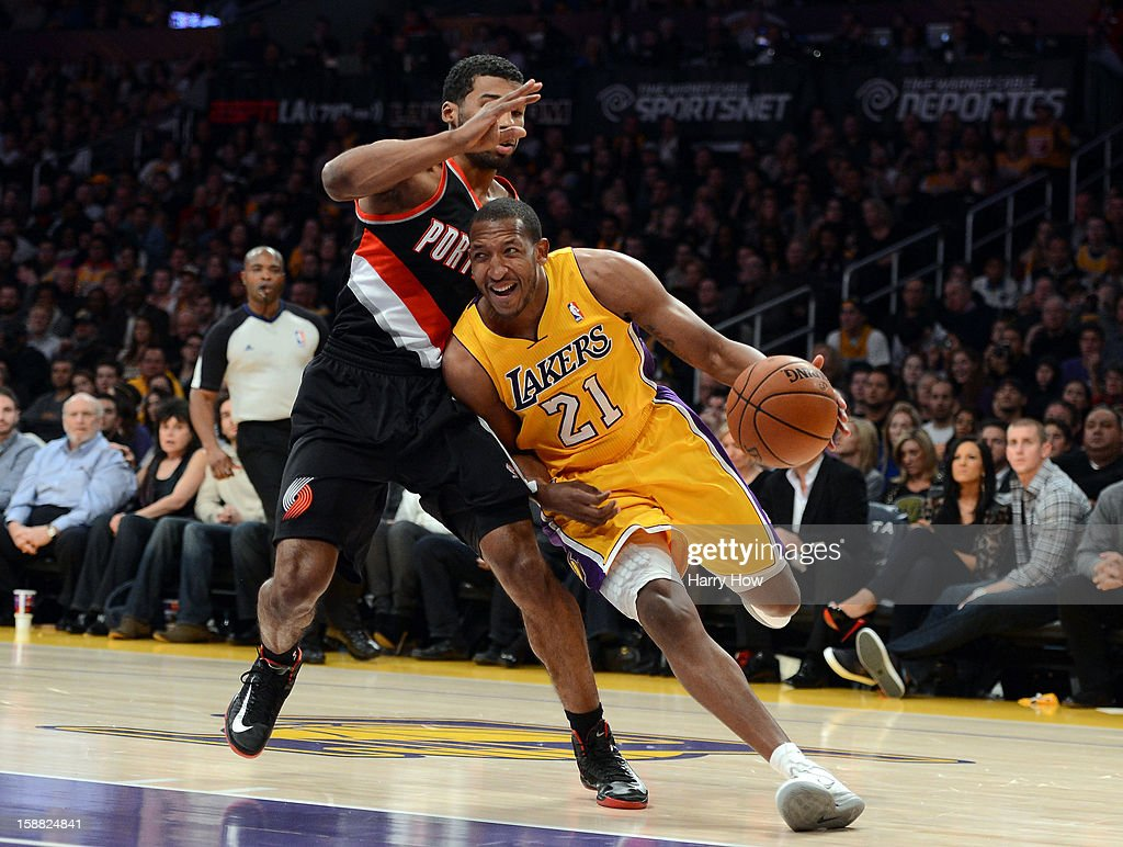 Chris Duhon #21 of the Los Angeles Lakers drives around Ronnie Price #24 of the Portland Trail Blazers at Staples Center on December 28, 2012 in Los Angeles, California. The Lakers won 104-87.
