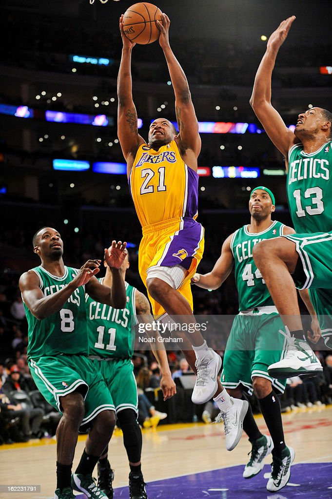 Chris Duhon #21 of the Los Angeles Lakers drives to the basket against Fab Melo #13 of the Boston Celtics at Staples Center on February 20, 2013 in Los Angeles, California.