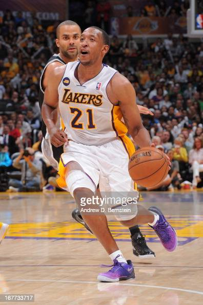 Chris Duhon of the Los Angeles Lakers drives to the basket against the San Antonio Spurs in Game Four of the Western Conference Quarterfinals during...