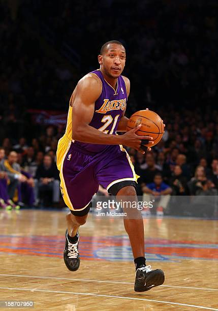 Chris Duhon of the Los Angeles Lakers in action against the New York Knicks at Madison Square Garden on December 13 2012 in New York City The Knicks...